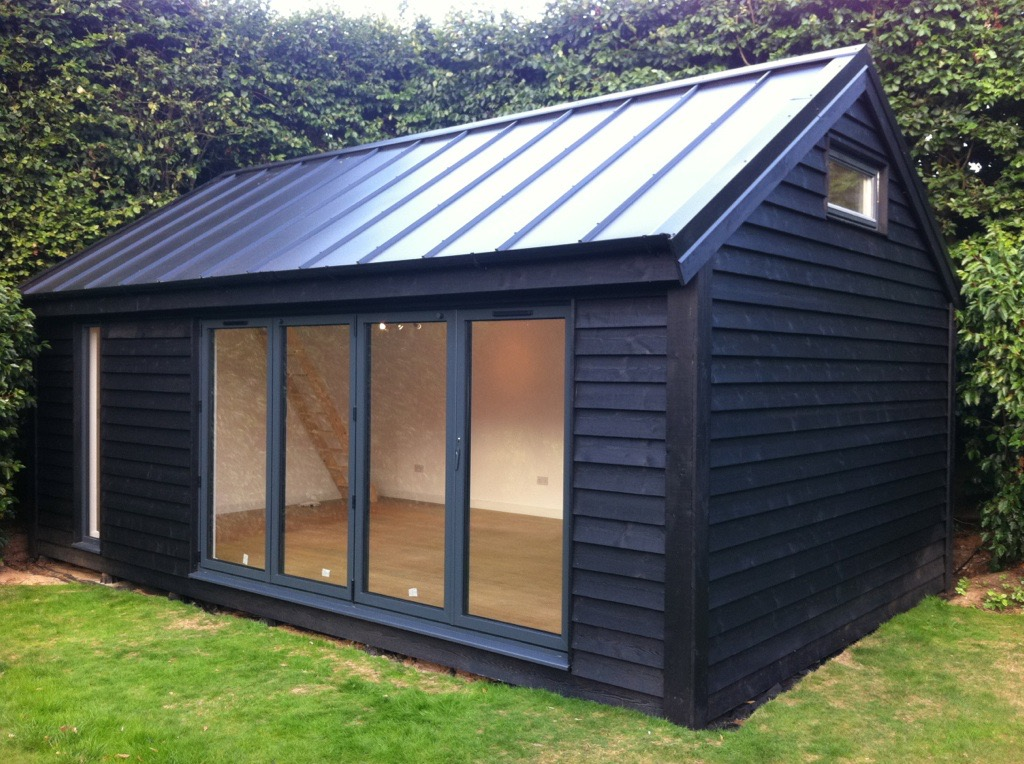 Delighful Garden Office With Cedar Shingles And A Log Burner In